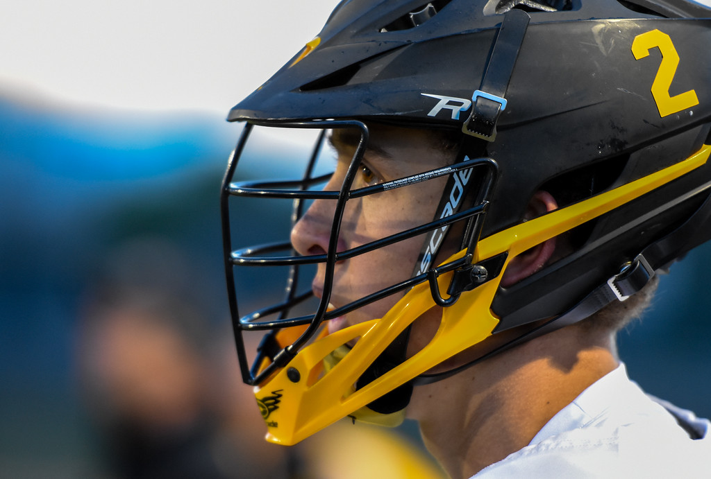 . Thompson Valley\'s Riley Kinney looks on from the sideline against Ponderosa on Tuesday May 1, 2018 at Patterson Stadium. (Cris Tiller / Loveland Reporter-Herald)