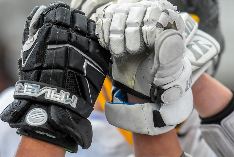 Thompson Valley boys lacrosse players huddle up before the start of the second half against Ponderosa on Tuesday May 1, 2018 at Patterson Stadium. (Cris Tiller / Loveland Reporter-Herald)