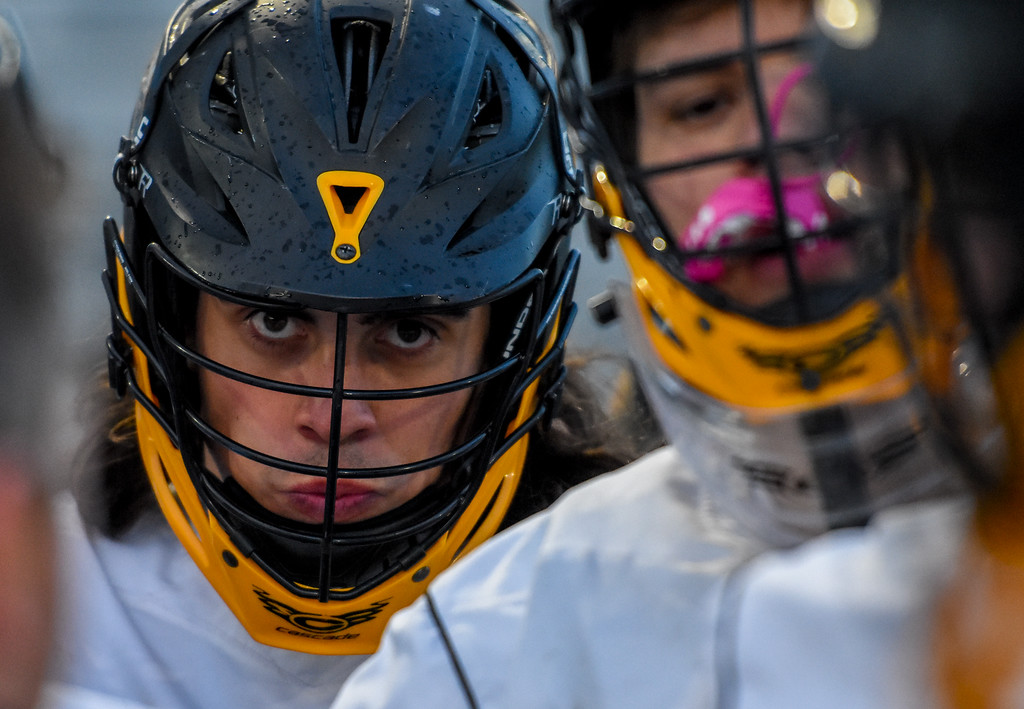 . Thompson Valley\'s Trey Cardenas looks on intently from a team huddle against Ponderosa on Tuesday May 1, 2018 at Patterson Stadium. (Cris Tiller / Loveland Reporter-Herald)