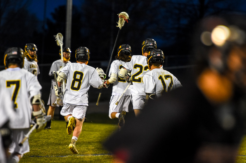 . Thompson Valley\' boys lacrosse players rush the field after beating  Ponderosa on Tuesday May 1, 2018 at Patterson Stadium. (Cris Tiller / Loveland Reporter-Herald)