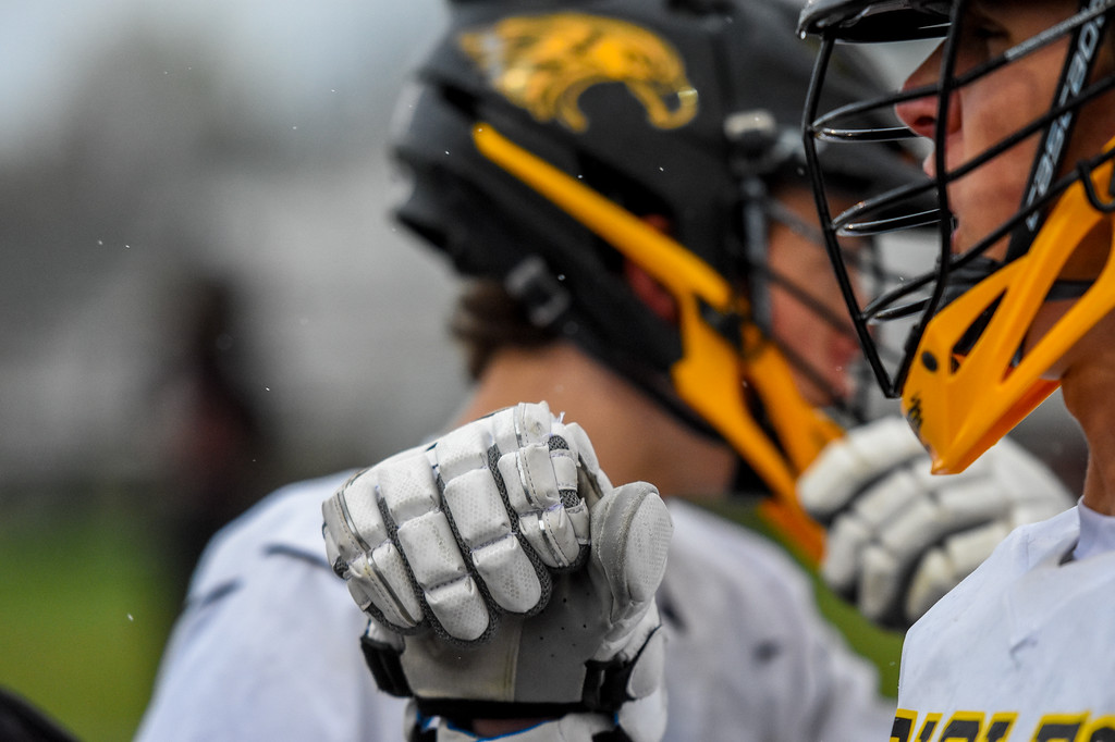 . A Thompson Valley boys lacrosse player pumps his fist in celebration as the rains falls against Ponderosa on Tuesday May 1, 2018 at Patterson Stadium. (Cris Tiller / Loveland Reporter-Herald)