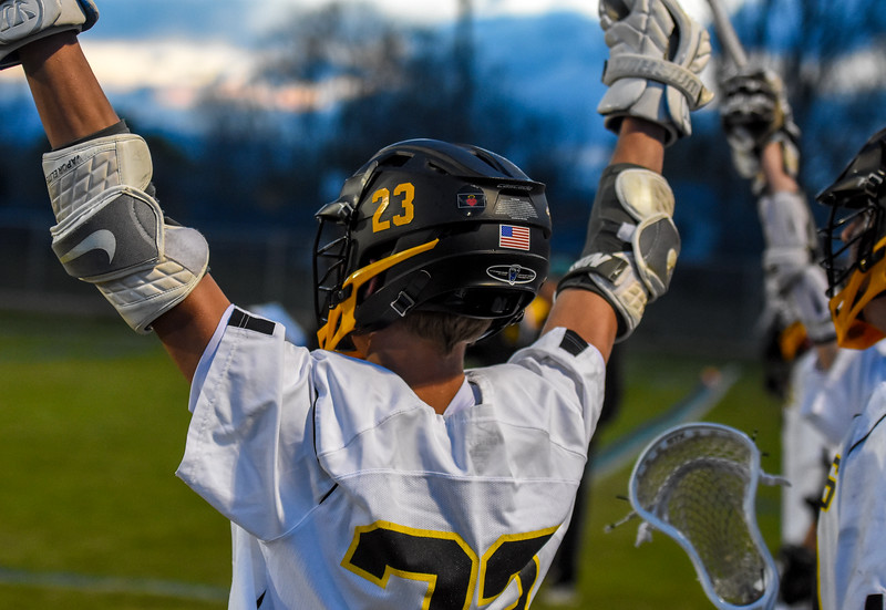 Thompson Valley's Eli Loomis cheers on from the sideline against Ponderosa on Tuesday May 1, 2018 at Patterson Stadium. (Cris Tiller / Loveland Reporter-Herald)
