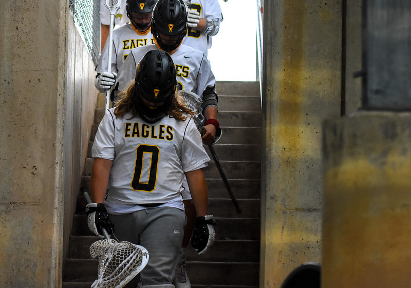 Thompson Valley boys lacrosse players exit the locker room back to the field against Ponderosa on Tuesday May 1, 2018 at Patterson Stadium. (Cris Tiller / Loveland Reporter-Herald)