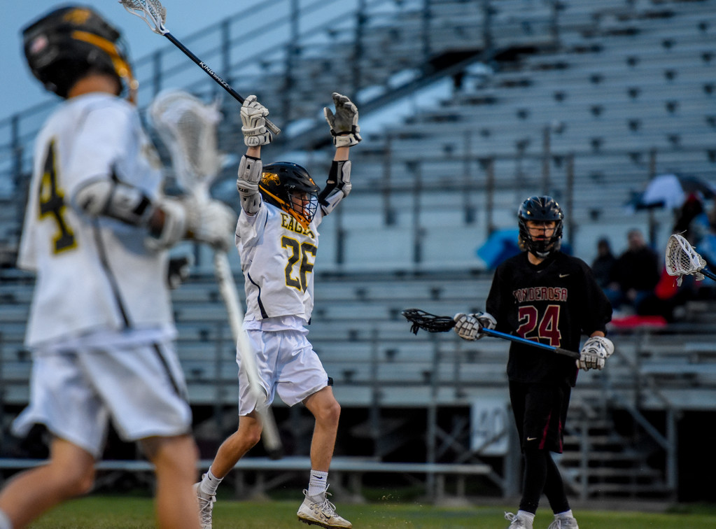 . Thompson Valley\'s Greg Bilek raises his arms after scoring against Ponderosa on Tuesday May 1, 2018 at Patterson Stadium. (Cris Tiller / Loveland Reporter-Herald)