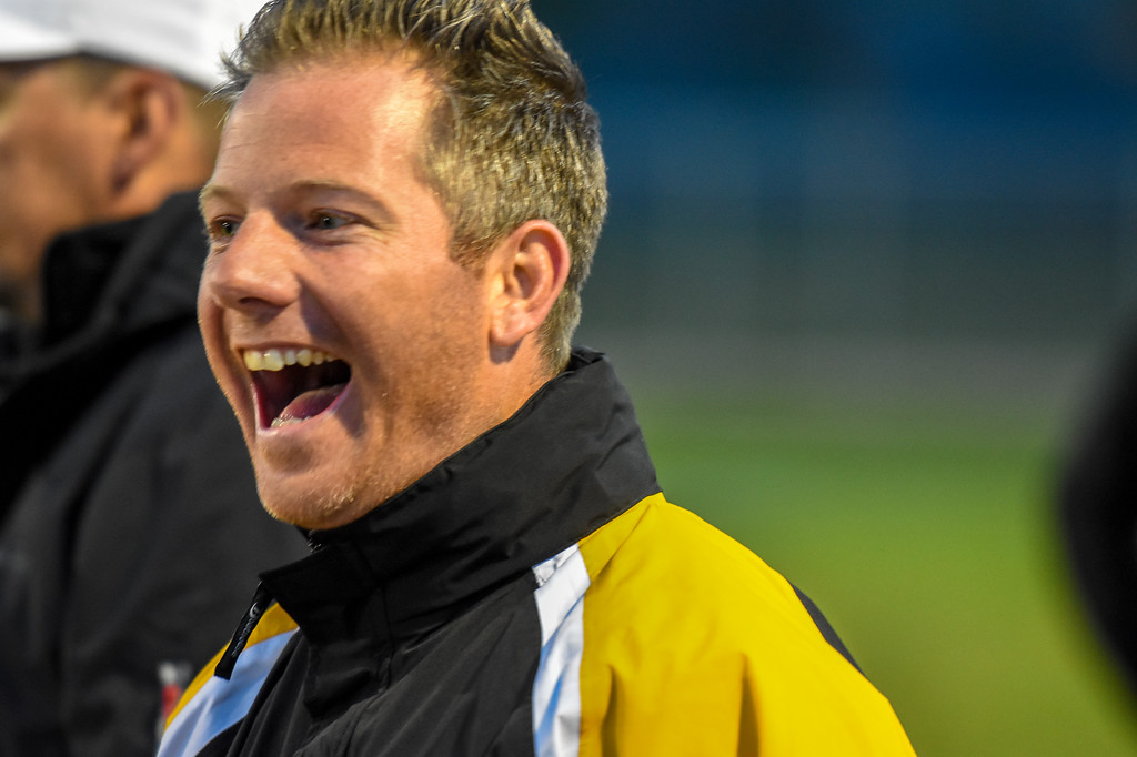 . Thompson Valley\'s boys lacrosse coach Will Cantwell smiles after his team executed a play for a goal against Ponderosa on Tuesday May 1, 2018 at Patterson Stadium. (Cris Tiller / Loveland Reporter-Herald)