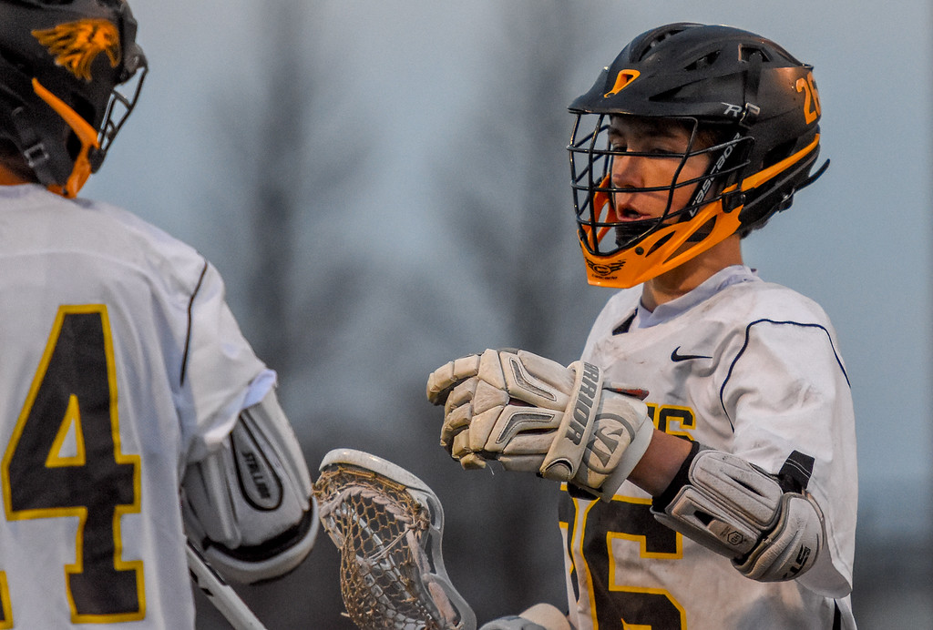 . Thompson Valley\'s Greg Bilek is congratulated after scoring a goal against Ponderosa on Tuesday May 1, 2018 at Patterson Stadium. (Cris Tiller / Loveland Reporter-Herald)