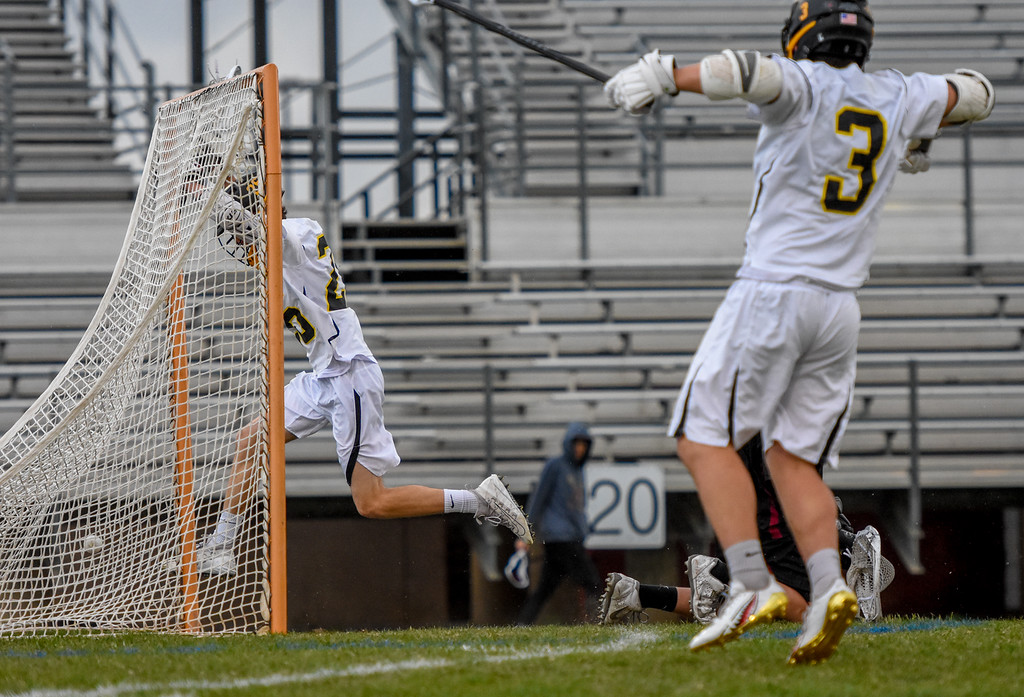 . Thompson Valley\'s Greg Bilek, left, jumps in celebration of his goal as does teammate Colby Mauck against Ponderosa on Tuesday May 1, 2018 at Patterson Stadium. (Cris Tiller / Loveland Reporter-Herald)