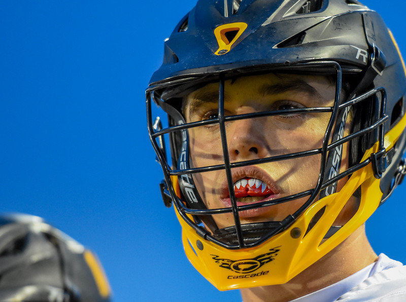 Thompson Valley's Travis Bretches shows off a fang-adorned mouthpiece against Ponderosa on Tuesday May 1, 2018 at Patterson Stadium. (Cris Tiller / Loveland Reporter-Herald)