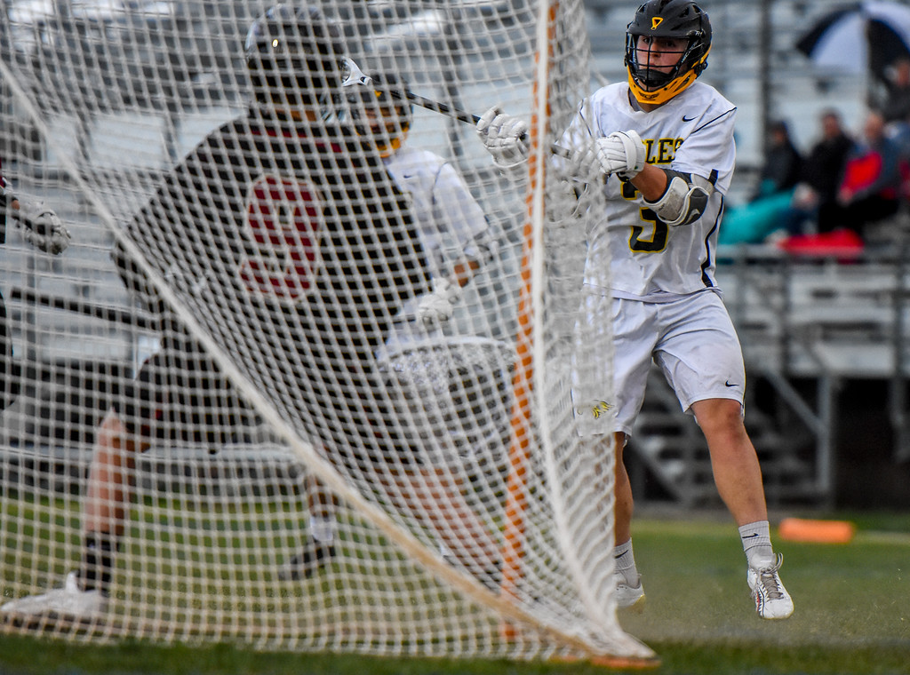. Thompson Valley\'s Colby Mauck (3) takes a shot against Ponderosa on Tuesday May 1, 2018 at Patterson Stadium. (Cris Tiller / Loveland Reporter-Herald)
