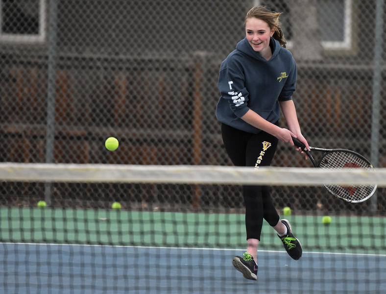 Thompson Valley's Jordan Mertens smiles as she attempts a shot during practice Thursday March 1, 2018 at the TVHS courts. (Cris Tiller / Loveland Reporter-Herald)