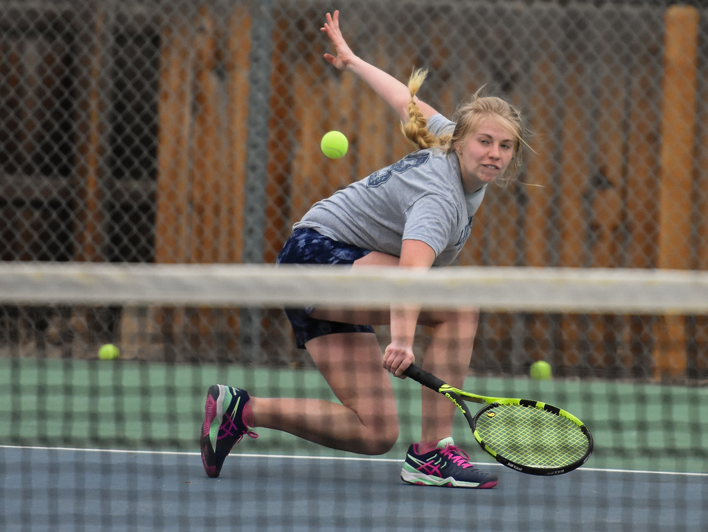 . Thompson Valley\'s Madison Sheets dips down for a backhand during practice Thursday March 1, 2018 at the TVHS courts. (Cris Tiller / Loveland Reporter-Herald)