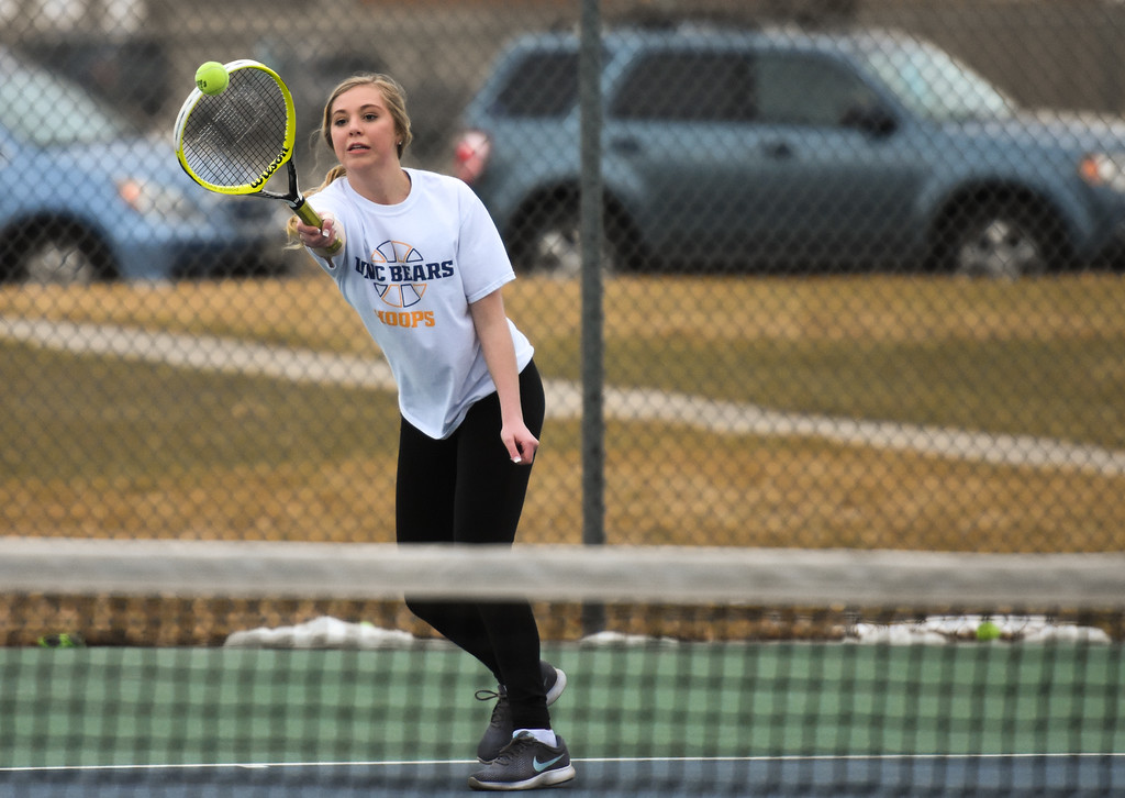 . Thompson Valley\'s Danielle Sobraske goes for a running backhand during practice Thursday March 1, 2018 at the TVHS courts. (Cris Tiller / Loveland Reporter-Herald)