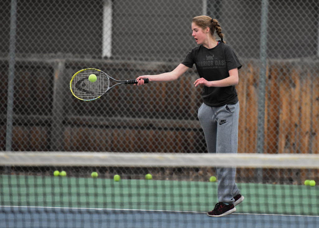 . Thompson Valley\'s Emily Black hits a forehand shot during practice Thursday March 1, 2018 at the TVHS courts. (Cris Tiller / Loveland Reporter-Herald)