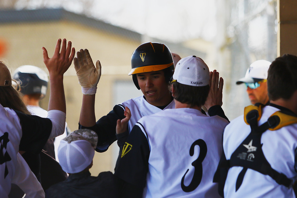 . Thompson Valley\'s Adrian Juarez is congratulated by teammates after driving in a run and scoring later himself against Centaurus on Saturday March 31, 2018 at Constantz Field at TVHS. (Javon Harris / For the Reporter-Herald)