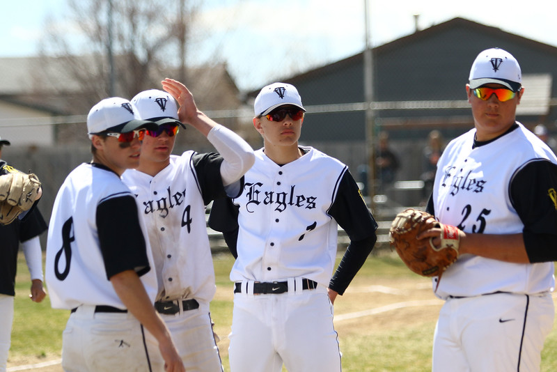Thompson Valley players look to the dugout for instruction between innings against Centaurus on Saturday March 31, 2018 at Constantz Field at TVHS. (Javon Harris / For the Reporter-Herald)