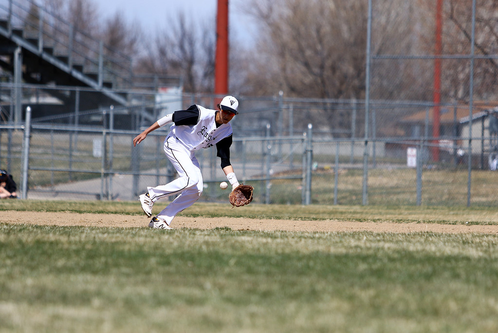 . Thompson Valley third baseman Jayden Raabe fields a ground ball against Centaurus on Saturday March 31, 2018 at Constantz Field at TVHS. (Javon Harris / For the Reporter-Herald)