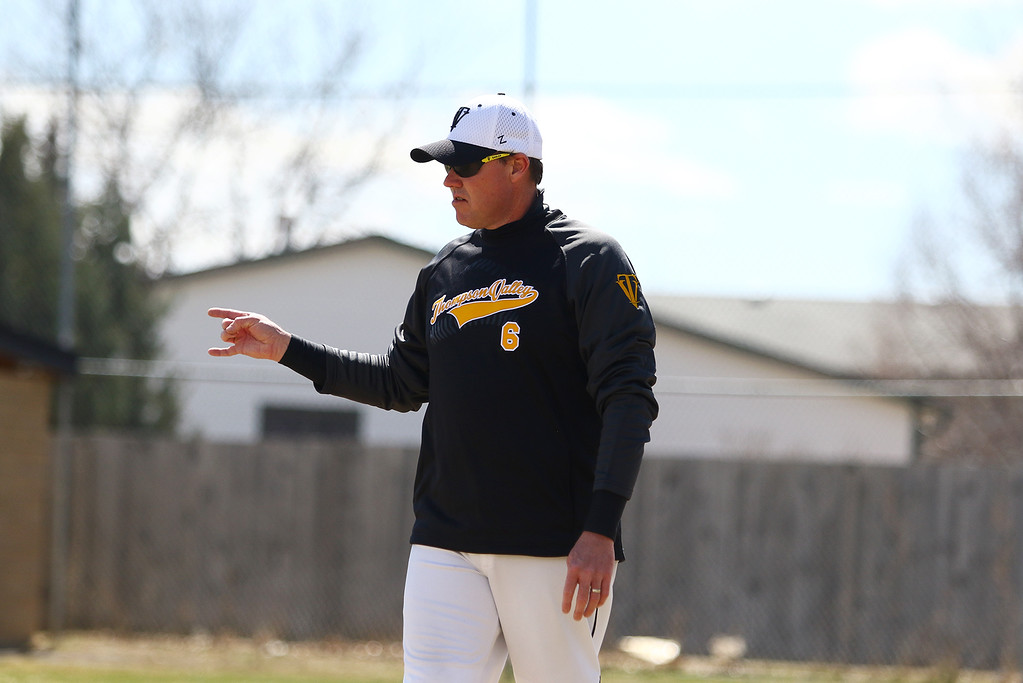 . Thompson Valley coach Jay Denning signs two outs against Centaurus on Saturday March 31, 2018 at Constantz Field at TVHS. (Javon Harris / For the Reporter-Herald)