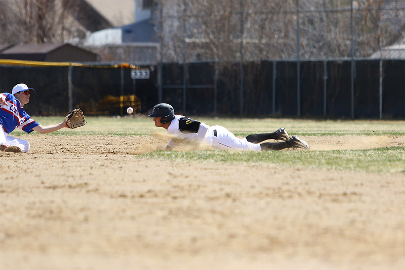 Thompson Valley's Cameron Nellor slides into second base against Centaurus on Saturday March 31, 2018 at Constantz Field at TVHS. (Javon Harris / For the Reporter-Herald)