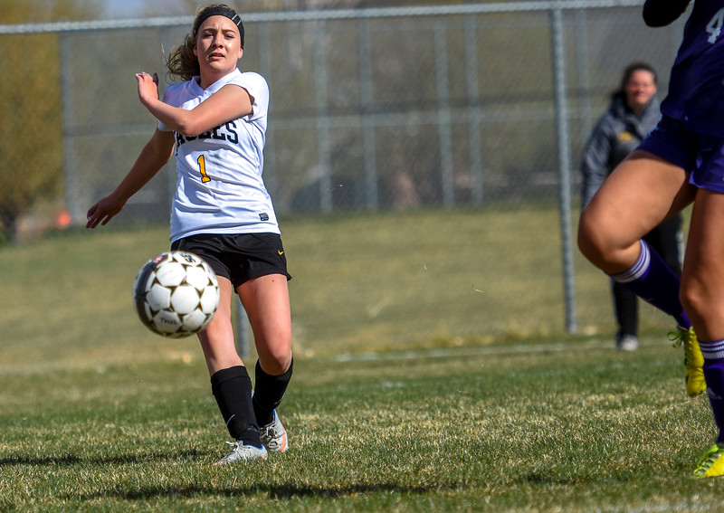 Thompson Valley's Emily McAllister sends in a cross against crosstown rival Mountain View on Tuesday April 17, 2018 at MVHS. (Cris Tiller / Loveland Reporter-Herald)
