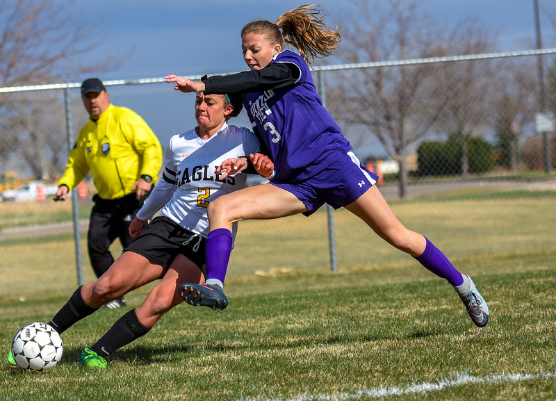 Mountain View's Jacey Paoli (3) defends a cross from Thompson Valley's Anna Mihaly on Tuesday April 17, 2018 at MVHS. (Cris Tiller / Loveland Reporter-Herald)