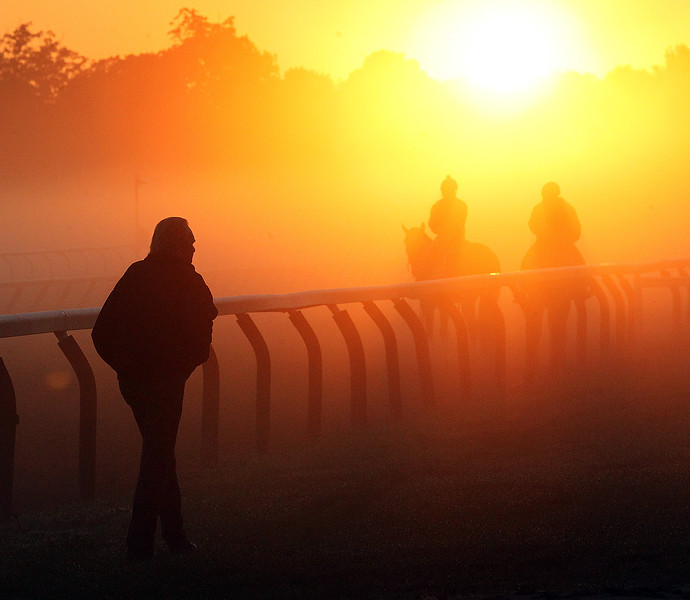 Spencer Tulis<br /> Fog rolls in over the Oklahoma training track at Saratoga Race Course Saturday as horses continue their routines as the venue gets ready for it's biggest day of the meet highlihjted by the Traver's Stakes.