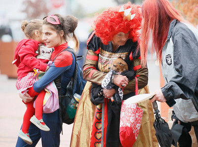 """Shaun Walker — The Times-Standard  Costumed humans and dogs roam trick-or-treat in Old Town Eureka on Saturday afternoon. Several other local communities held early Halloween events and the Sequoia Park Zoo holds Boo at the Zoo today, with activities from noon to 4 p.m. It features crafts and games, face painting, an extinction trail, and the """"animal pumpkin stomp and chomp!"""""""