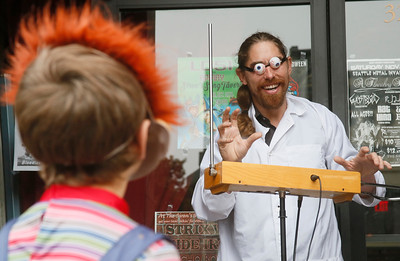 Shaun Walker — The Times-Standard  Nicholas Neil of Arcata, right, plays an eery theremin as a costumed boy looks on. The electronic musical instrument is controlled without physical contact by the player.