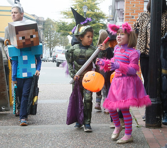 "Shaun Walker — The Times-Standard  Kai Johnson, 8, left, Jahmel Nester,7, and Petra Bunz, 7, trick-or-treat in Old Town Eureka on Saturday afternoon. Several other local communities held early Halloween events and the Sequoia Park Zoo holds Boo at the Zoo today, with activities from noon to 4 p.m. It features crafts and games, face painting, an extinction trail, and the ""animal pumpkin stomp and chomp!"""