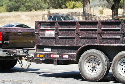 More than one vehicle was seen with pink fire retardant covering their cab Saturday July 8, 2017 in Oroville, California.  (Emily Bertolino -- Enterprise-Record)