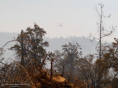 Helicopters and airplanes are seen and heard through billows of smoke as Cal Fire Butte County and other agencies work to contain the Wall Fire Saturday July 8, 2017 in Oroville, California.  (Emily Bertolino -- Enterprise-Record)