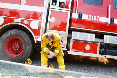 With temperatures well above 100 degrees a firefighter takes a rest from the strenuous work of helping contain the Wall Fire Saturday July 8, 2017 in Oroville, California.  (Emily Bertolino -- Enterprise-Record)