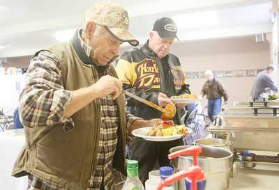 Shaun Walker — The Times-Standard  Dick Fedder of Fickle hill, who was in the Marines from 1957-60, left, and Wayne Palmer of Mckinleyville, who was in the Army 1966-68, fill their plates at the Warrior's Lunch at the Arcata Veterans Hall on Wednesday. American Legion Arcata Post 274 serves the meal from noon to 2 p.m. on the first Wednesday of every month. All are welcome to come and meet local veterans from multiple eras and enjoy the food. On Friday, Nov.10, at 6 p.m., there is a Marine Corps Ball there celebrating the 242nd birthday of the service, and the College of the Redwoods Big Band will play. On Thanksgiving day, the second annual harvest feast will be hosted at the hall.