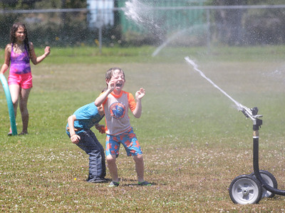 Shaun Walker — The Times-Standard  Kaiser, 5, plays in sprinkler spray at Camp Perigot in Blue Lake on Wednesday. The Blue Lake Parks and Recreation summer day camp also features games, arts and crafts, sports, roller skating, theater, field trips, cooking, and gardening.