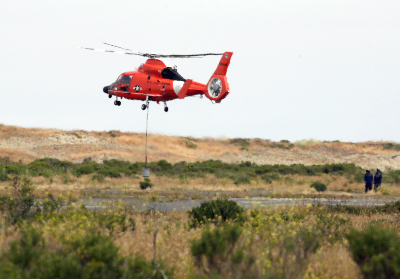 Shaun Walker — The Times-Standard  A U.S. Coast Guard MH-65 Dolphin helicopter crew trains at the Samoa Airport on Wednesday. Coast Guard Air Station Humboldt Bay in McKinleyville operates three of the helicopters, which are the service's primary rescue helicopters.