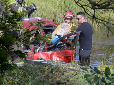 Shaun Walker — The Times-Standard  Humboldt Bay firefighters extricate a 73-year-old woman from her car after an accident south of Indianola on Highway 101 just after 5 p.m. on Thursday. She and another driver, who was uninjured, were traveling northbound when they collided and her car crashed through heavy vegeation and into a slough, said a Eureka Police officer. She had some upper body pain and was taken to St. Joseph Hospital.