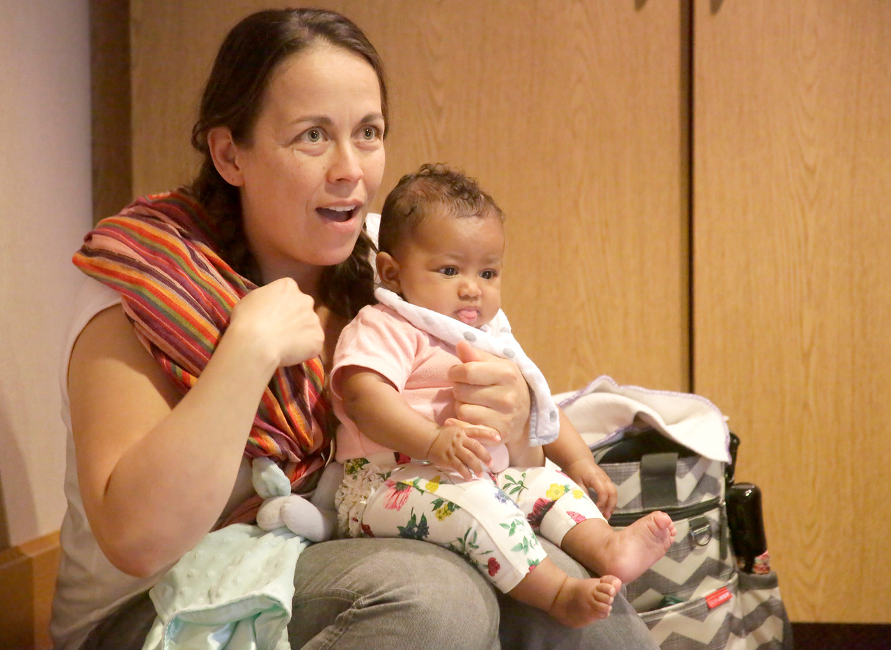 Shaun Walker — The Times-Standard  Rachel Hernandez of Eureka signs along to a song as she holds daughter Josephine, 4 months, during a Baby Sign Workshop at the Humboldt County Library in Eureka on Saturday. The workshop is held at 11:30 a.m. every second Saturday of the month, except August. The September workshop theme is My First Signs. For more information, call 269-1910.