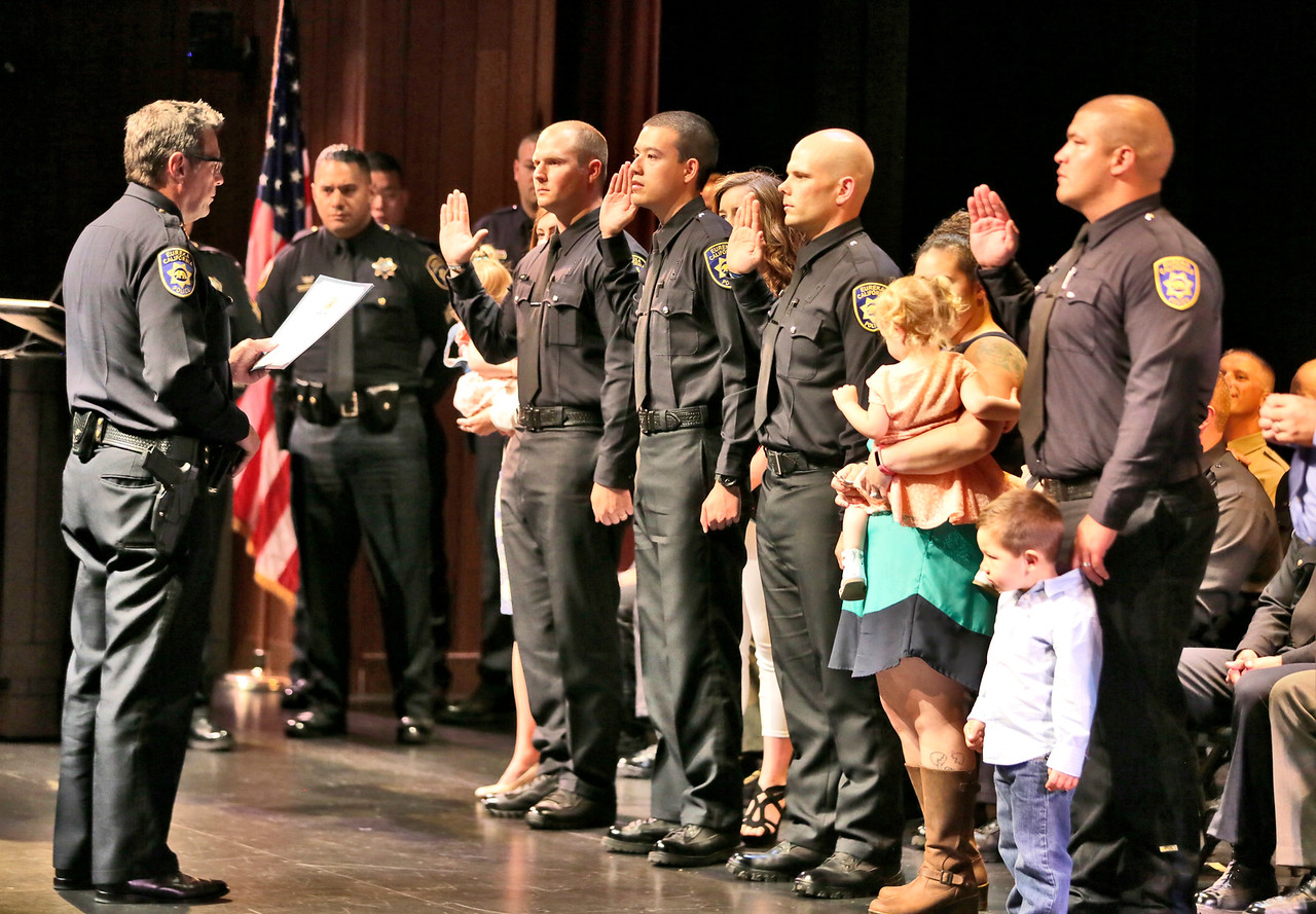 Shaun Walker — The Times-Standard  Eureka Police Chief Andrew Mills, far left, swears in new officers Nicholas Dalby, facing him at left, Nicholas Quon, Joseph Couch, and Bran Wilson at the end of the College of the Redwoods 119th Basic Law Enforcement Academy graduation on Thursday afternoon. Thirty-one cadets graduated. Of those graduating, twenty-four have been hired by various law enforcement departments and others are in different stages of the selection processes.