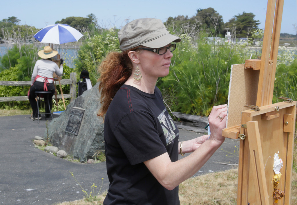. Shaun Walker � The Times-Standard  Charane Sirrine, a student in Michael Hayes\' painting class, uses oil paints to paint Indian Island and Humboldt Bay from Woodley Island on Tuesday. The class of about 10 students tries to paint outside about once a week, weather permitting.