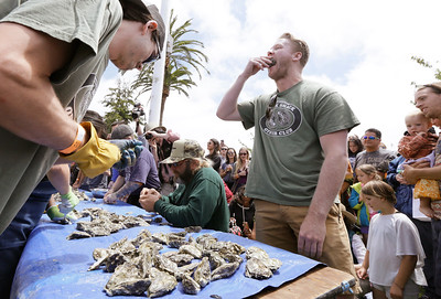 Shaun Walker — The Times-Standard  Brian Gamble, right, and Steven Moak, both of San Diego, compete in the Shuck and Suck contest.
