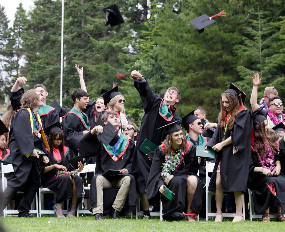 . Shaun Walker � The Times-Standard  Graduates celebrate at the end of Eureka High School\'s graduation ceremony on Friday. The school graduated about 250 seniors in Albee Stadium.