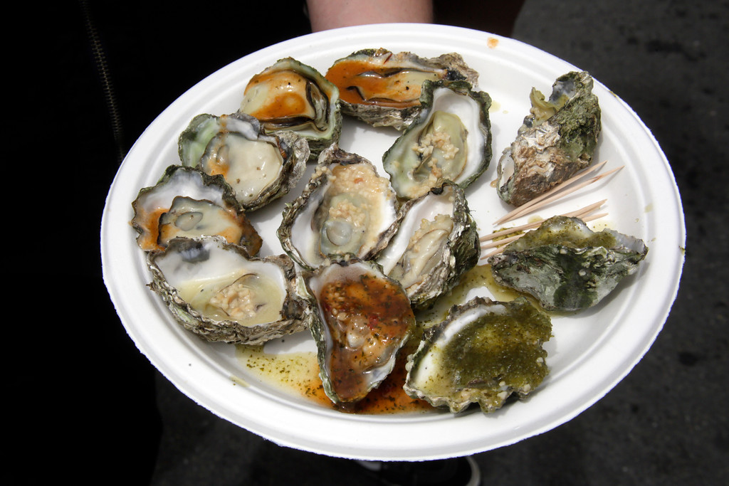. Shaun Walker � The Times-Standard  Oysters are sauced up and ready to be eaten at the festival.