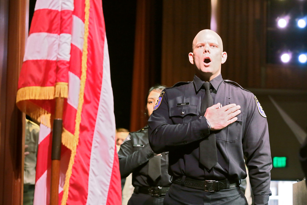 Shaun Walker — The Times-Standard  Cadet Joseph Couch leads the Pledge of Allegiance at the College of the Redwoods 119th Basic Law Enforcement Academy graduation on Thursday afternoon. Thirty-one cadets graduated. Of those graduating, twenty-four have been hired by various law enforcement departments and others are in different stages of the selection processes.