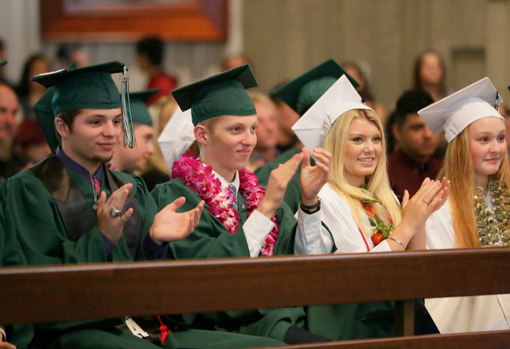 . Shaun Walker � The Times-Standard  St. Bernard\'s Academy seniors clap at the Eureka school\'s graduation ceremony on Saturday. The private Catholic school graduated 48 students.