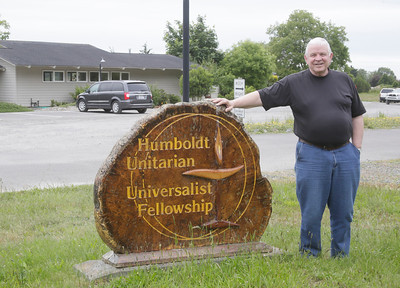 Shaun Walker — The Times-Standard  Minister Bryan Jessup stands outside the Humboldt Unitarian Universalist Fellowship in Bayside on Thursday afternoon. The congregation there declared itself to be a Sanctuary Congregation earlier this month.