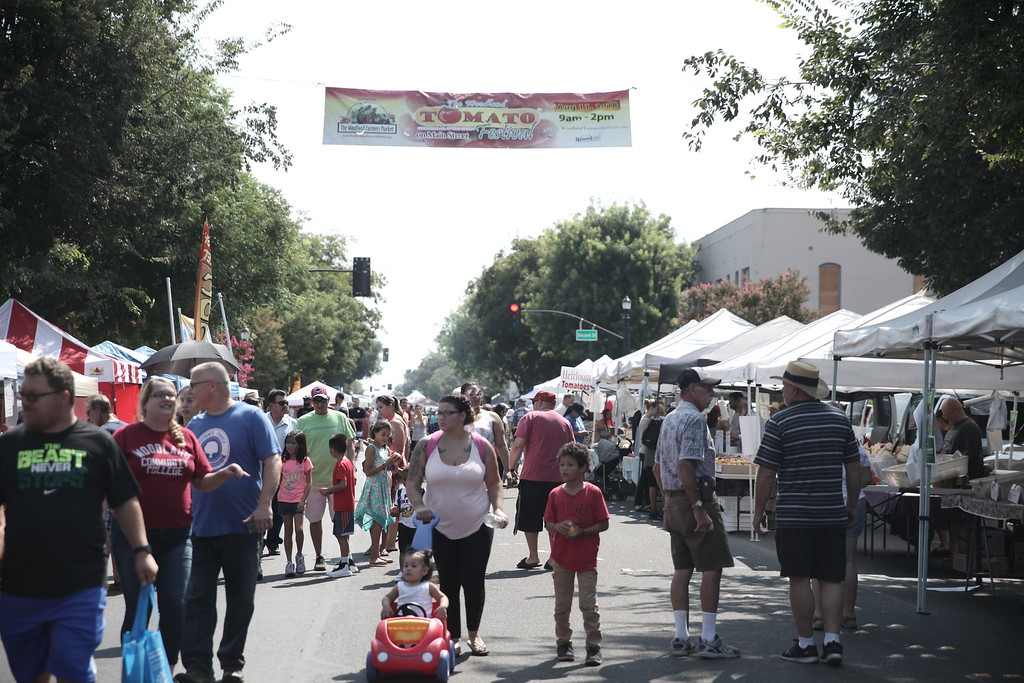 . SARAH DOWLING AND CINTIA LOPEZ - DAILY DEMOCRAT  Thousands turned out to the Woodland Tomato Festival this year. The event - focused around Yolo County\'s top crop, featured a farmers market, food, dunk tank, games and rides for kids, as well as chef and salsas competitions.