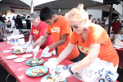 SARAH DOWLING AND CINTIA LOPEZ - DAILY DEMOCRAT  Thousands turned out to the Woodland Tomato Festival this year. The event - focused around Yolo County's top crop, featured a farmers market, food, dunk tank, games and rides for kids, as well as chef and salsas competitions.
