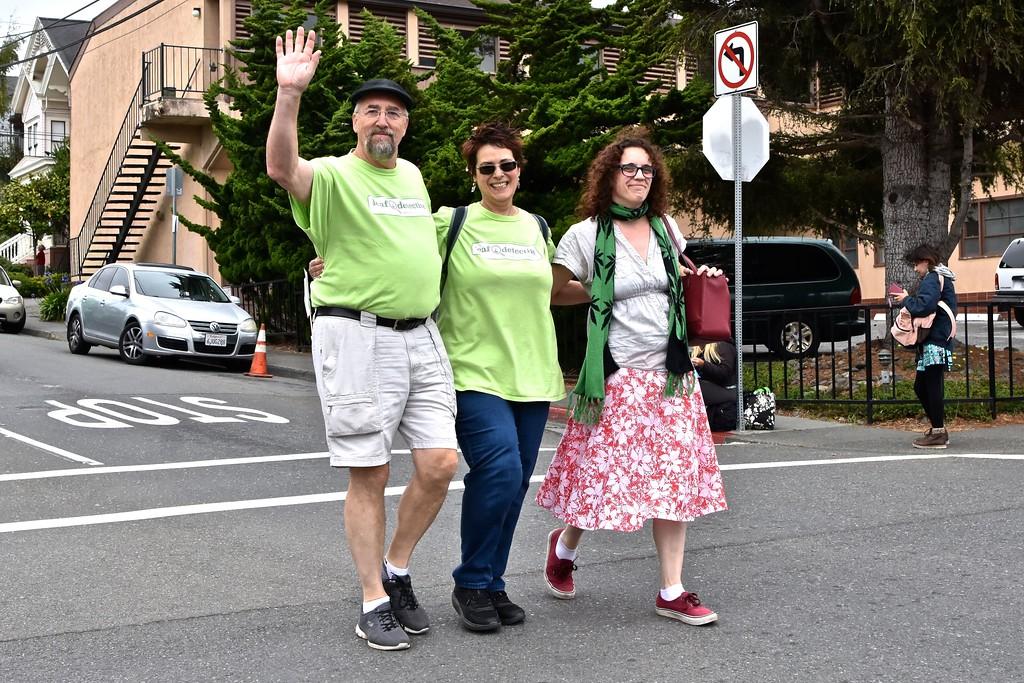 . Cannabis business organizer Allison Edrington, far right, walks the parade with friends.  José Quezada�For the Times-Standard