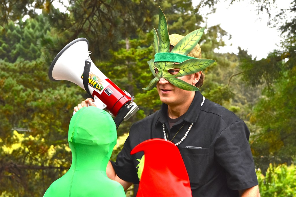 . Yes We Cann organizer Stephan Gieder announces the formation timing for the start of the parade from Humboldt State University.  José Quezada�For the Times-Standard
