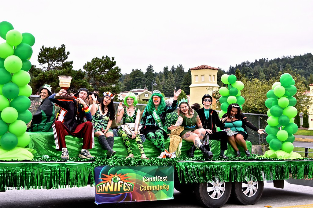 . Cannabis Royalty, aspiring to be Cannabis King and Queen for 2017, cross at Lakewood Boulevard and 14th Street, Arcata. José Quezada � For Times-Standard
