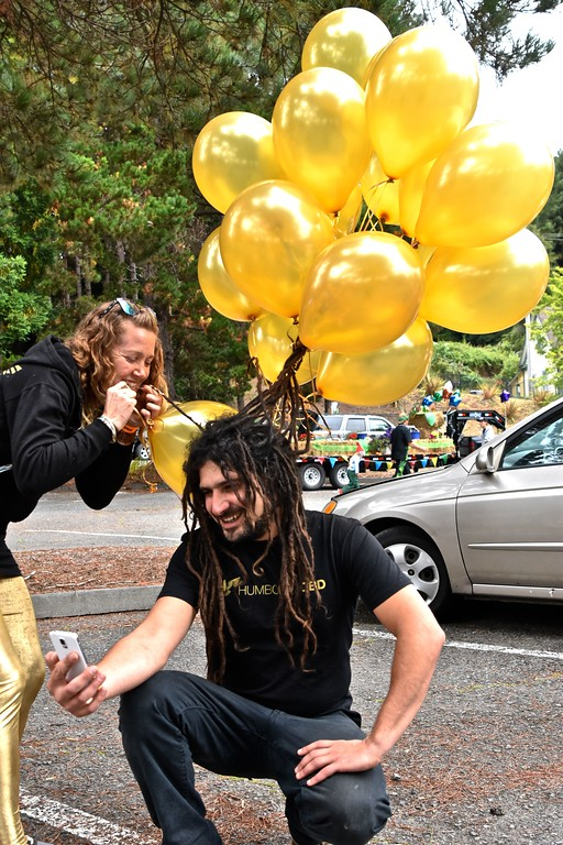 . Avishai Bombaklat of Humboldt CBD has his dreads tied to helium-filled balloons. José Quezada�For Times-Standard
